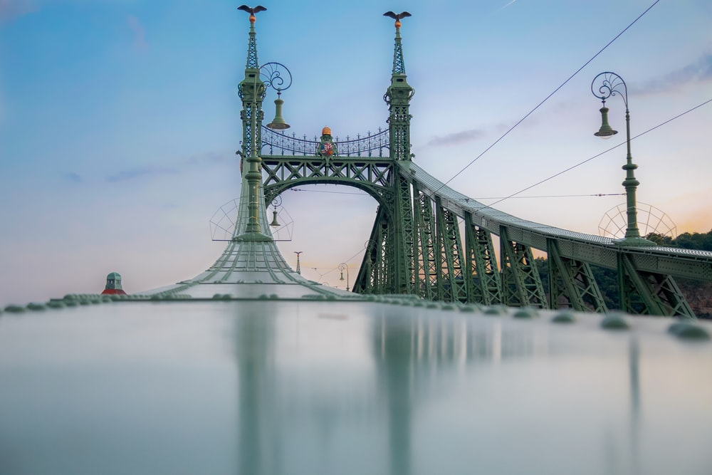 grey bridge under clear blue sky