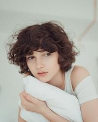 woman hugging white pillow