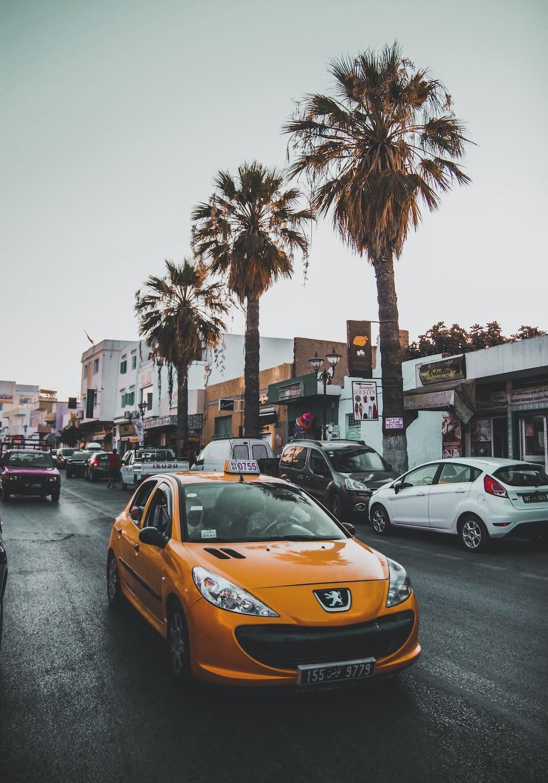 orange Peugeot sedan parked ahead
