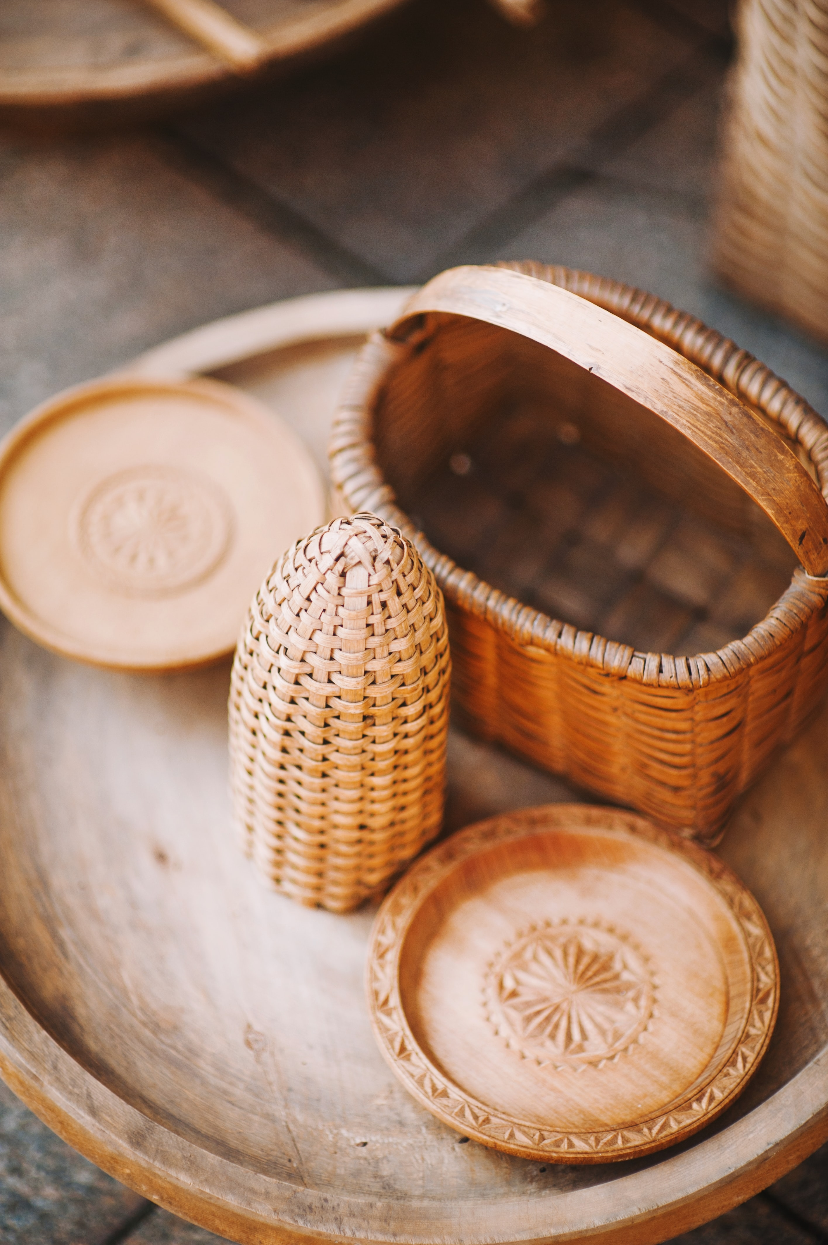 brown wicker basket on round tray