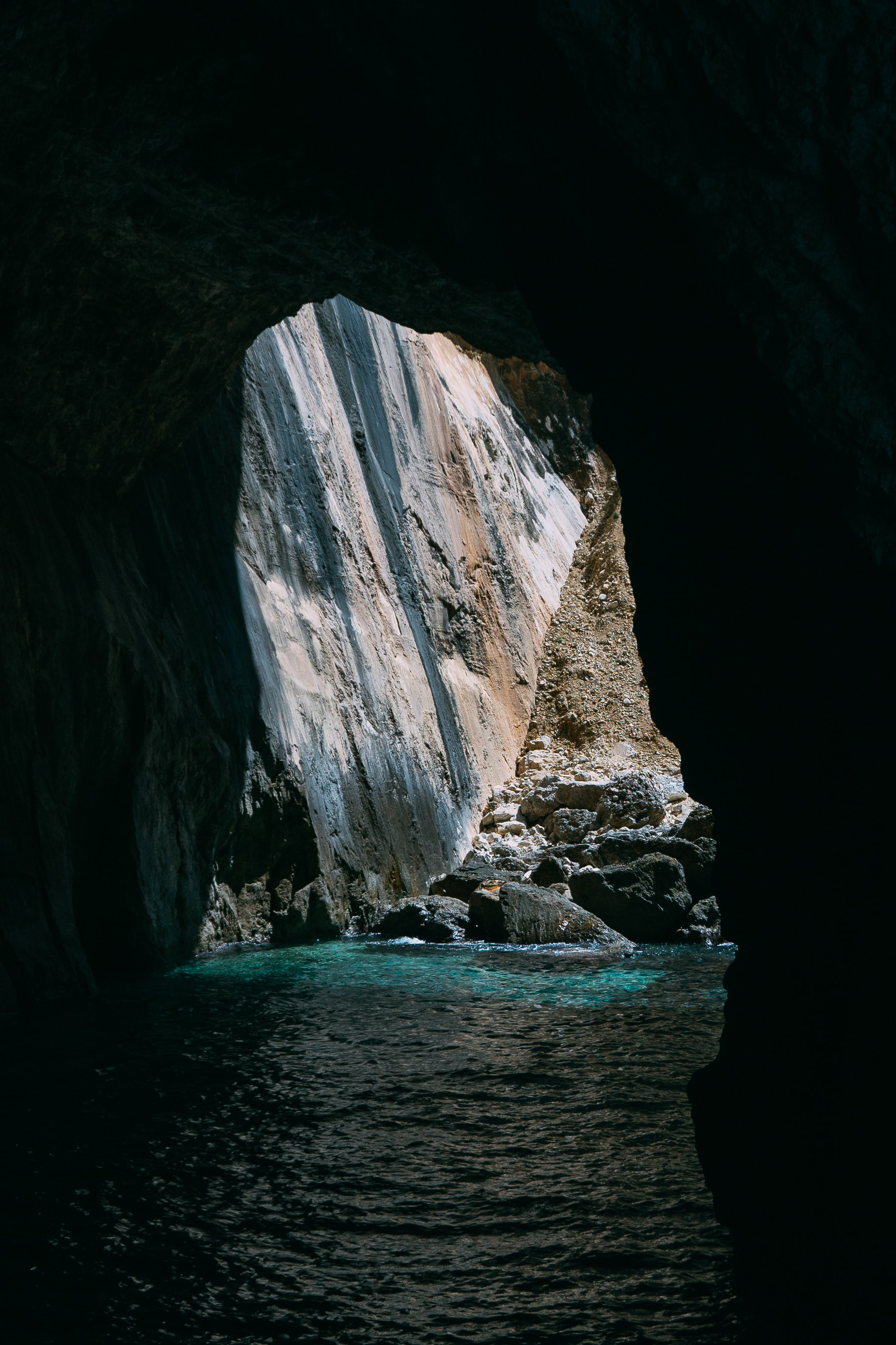 body of water under cave