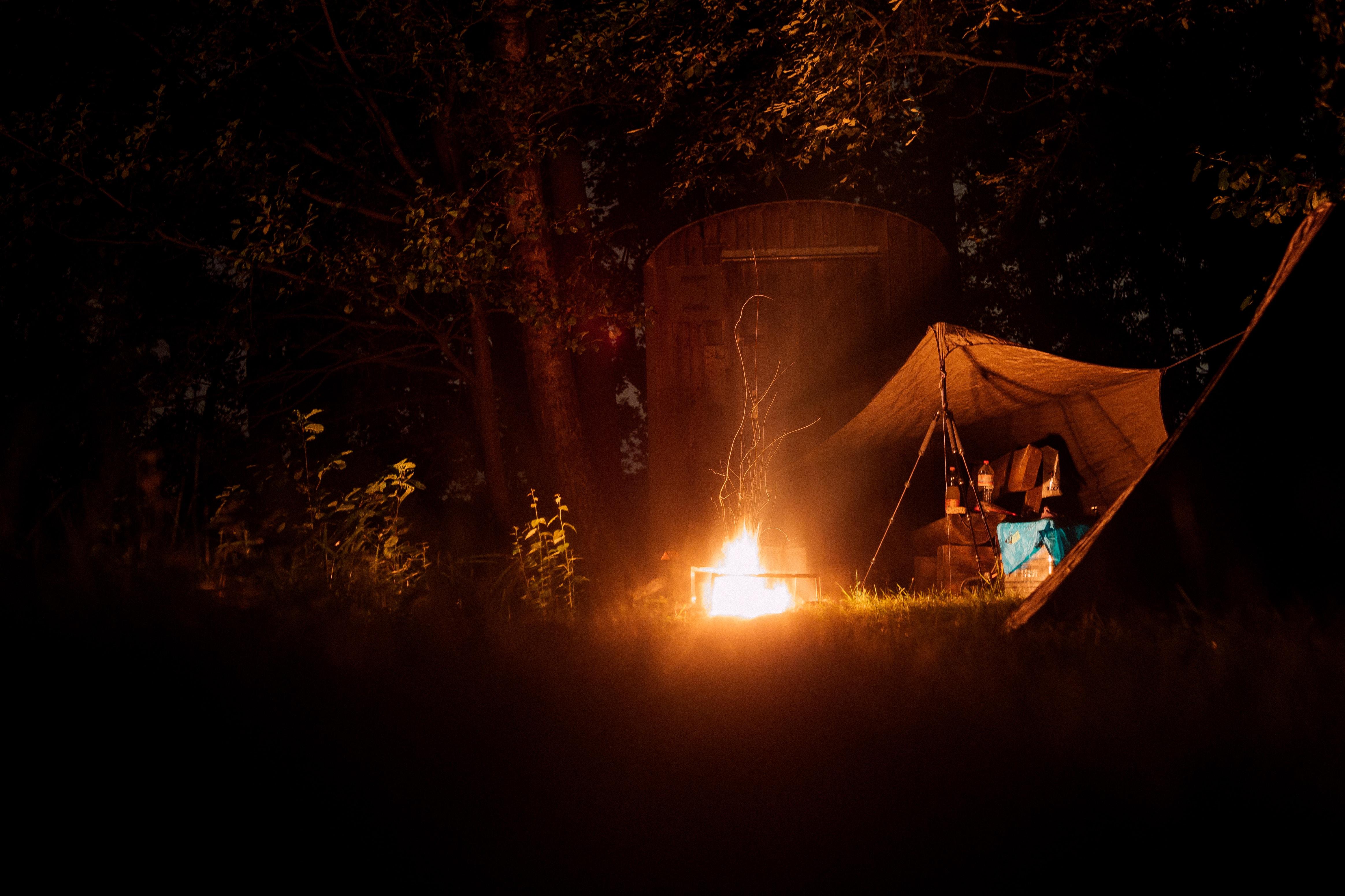 lit bonfire near tent