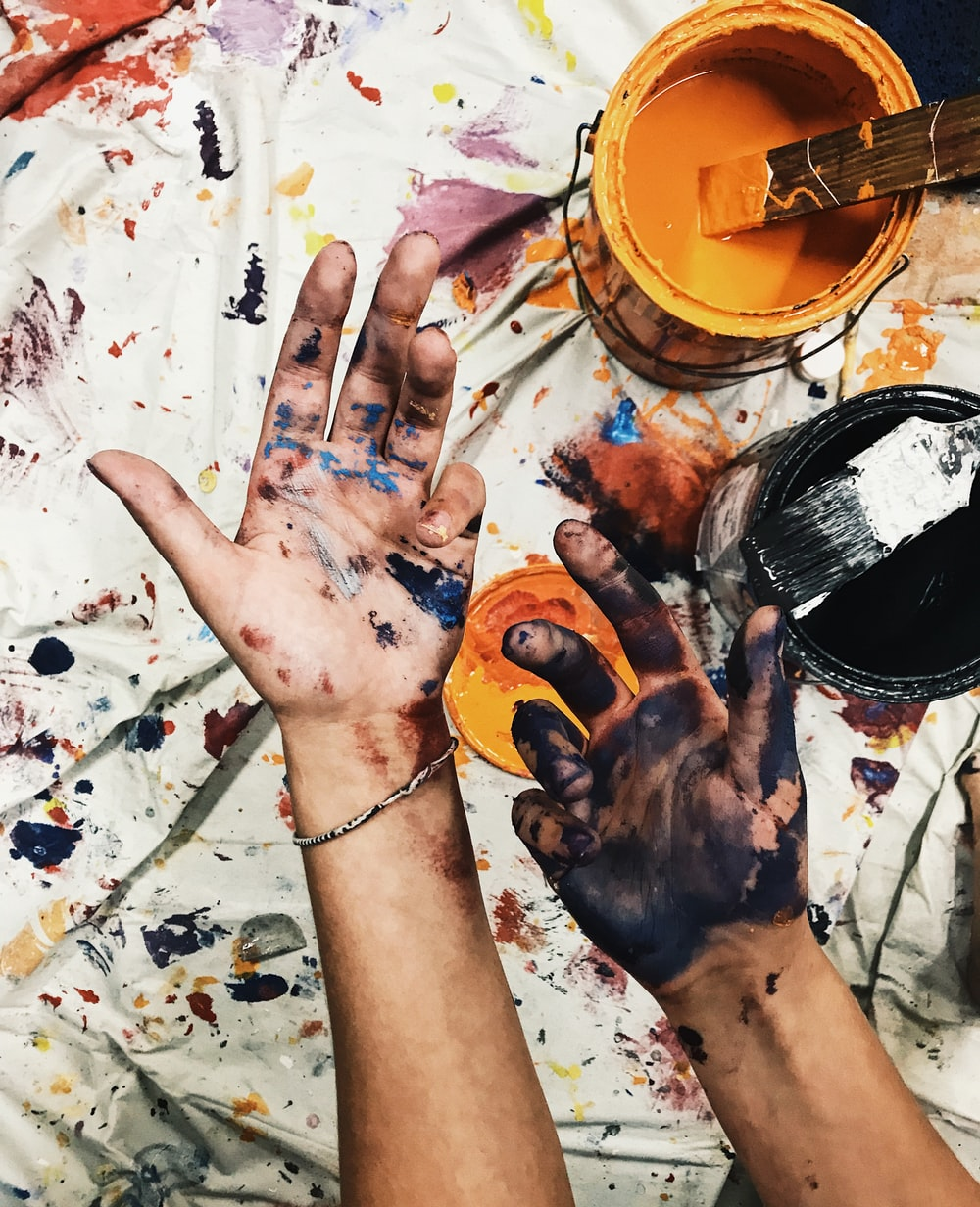 person with painted hands