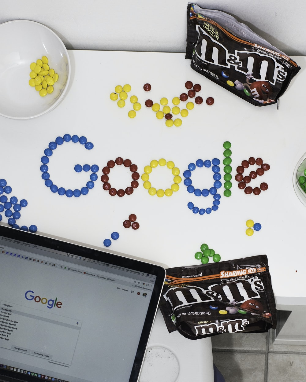 photo of M&M forming Google chocolate candies on table