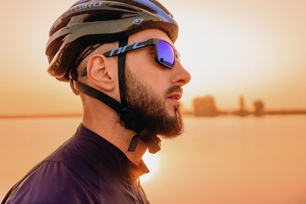 man wearing black bike helmet