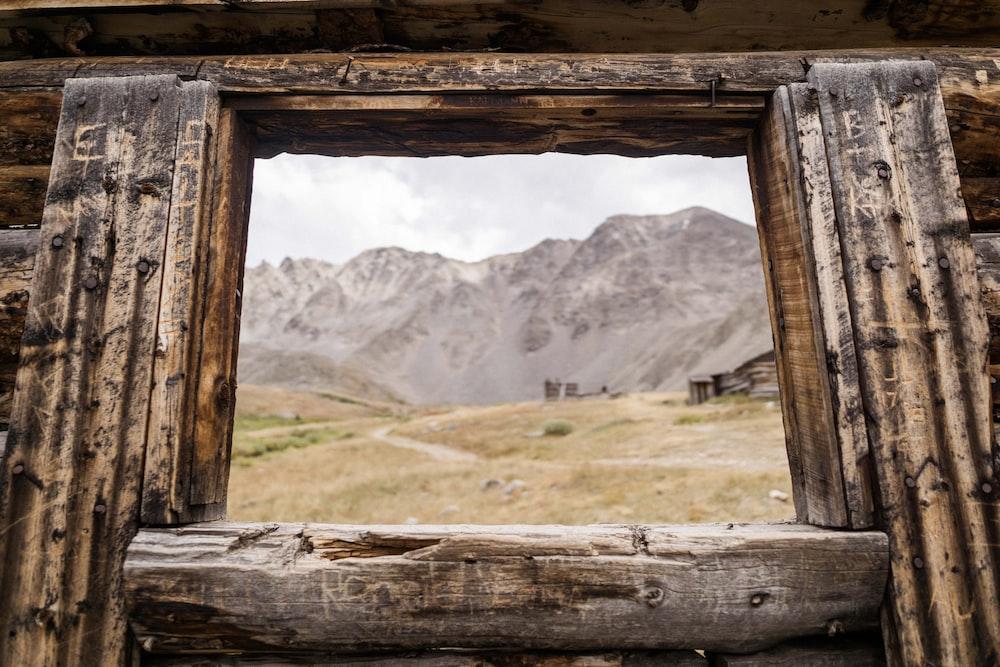 brown wooden window at daytime