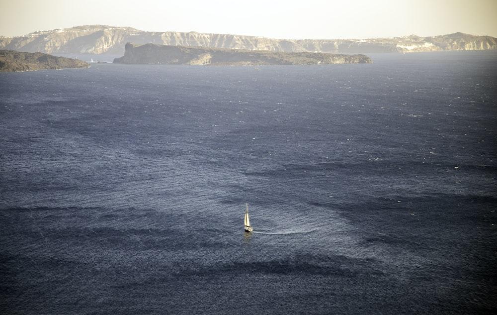 sailboat on ocean during daytime
