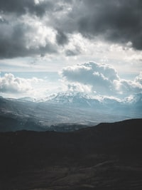 mountains under white clouds