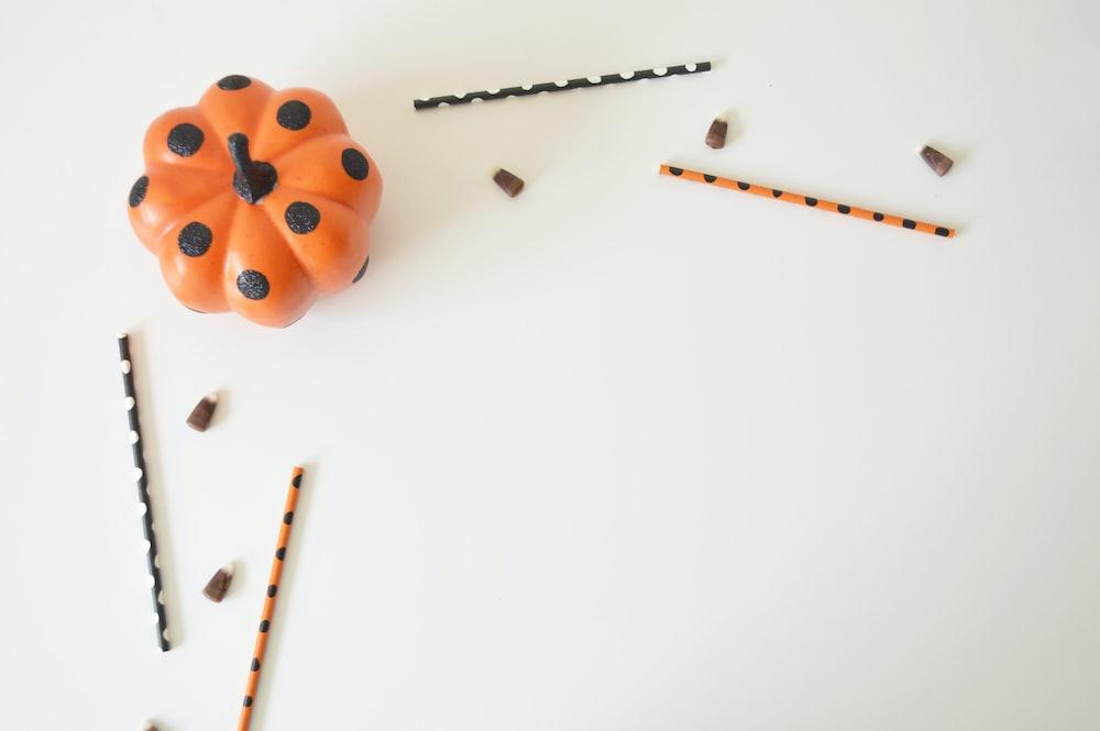 orange and black pumpkin toy