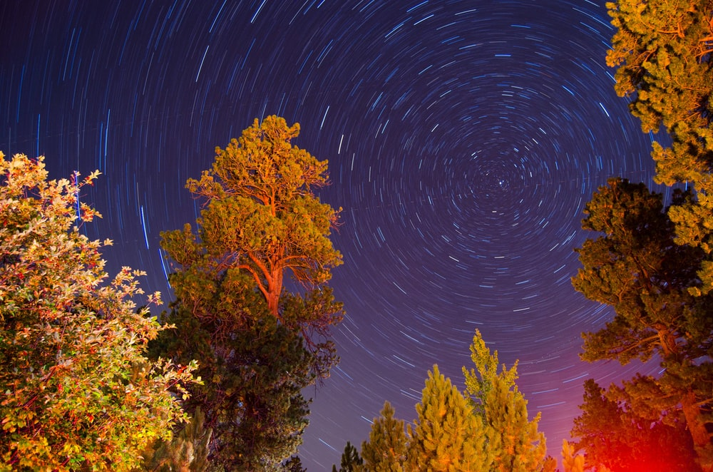 time lapse photography of night stars