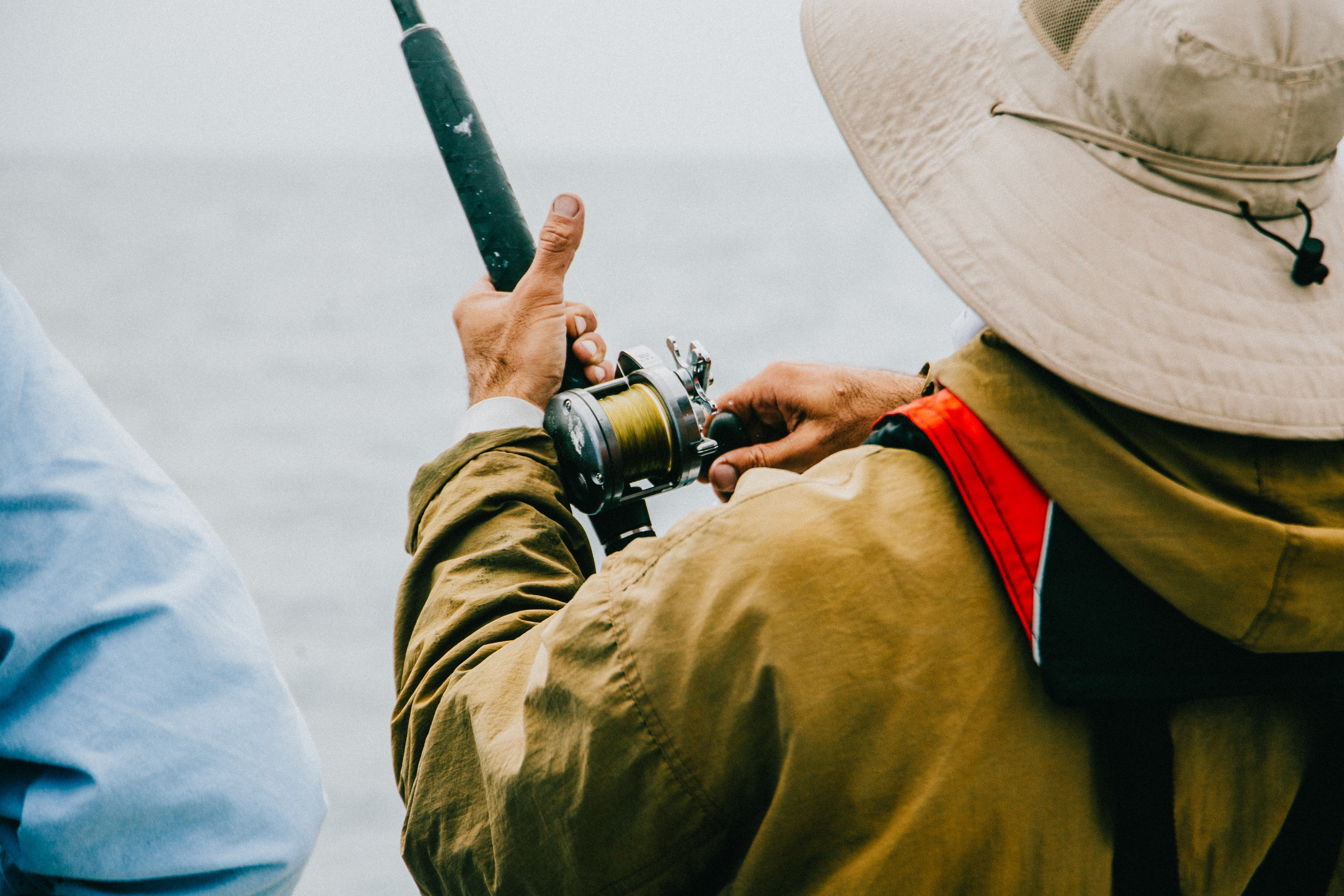 person holding black fishing rod
