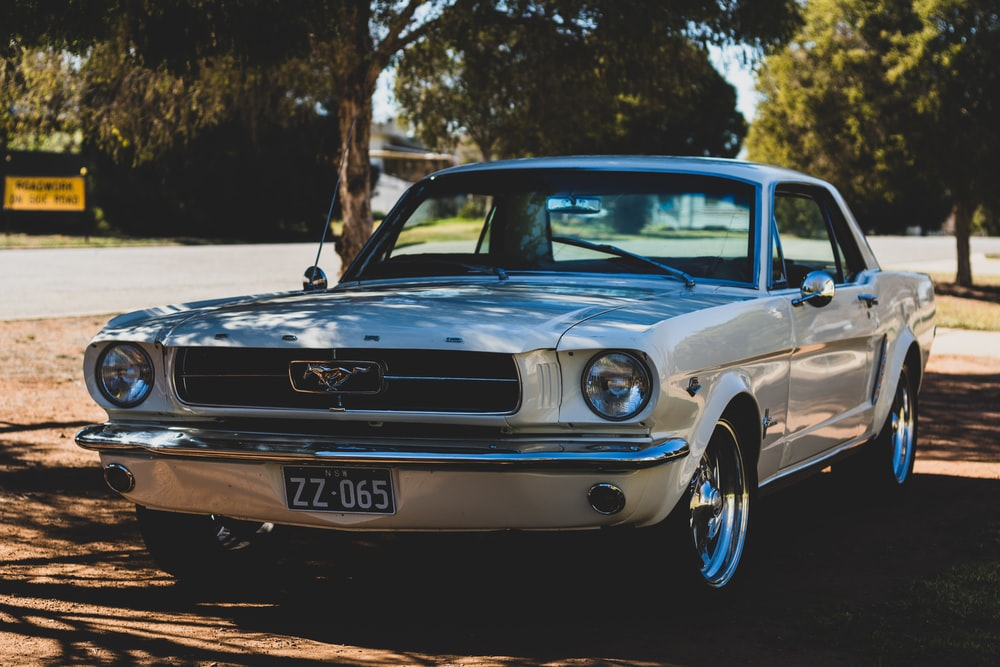 white Ford Mustang coupe