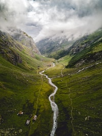aerial photography of river between mountains