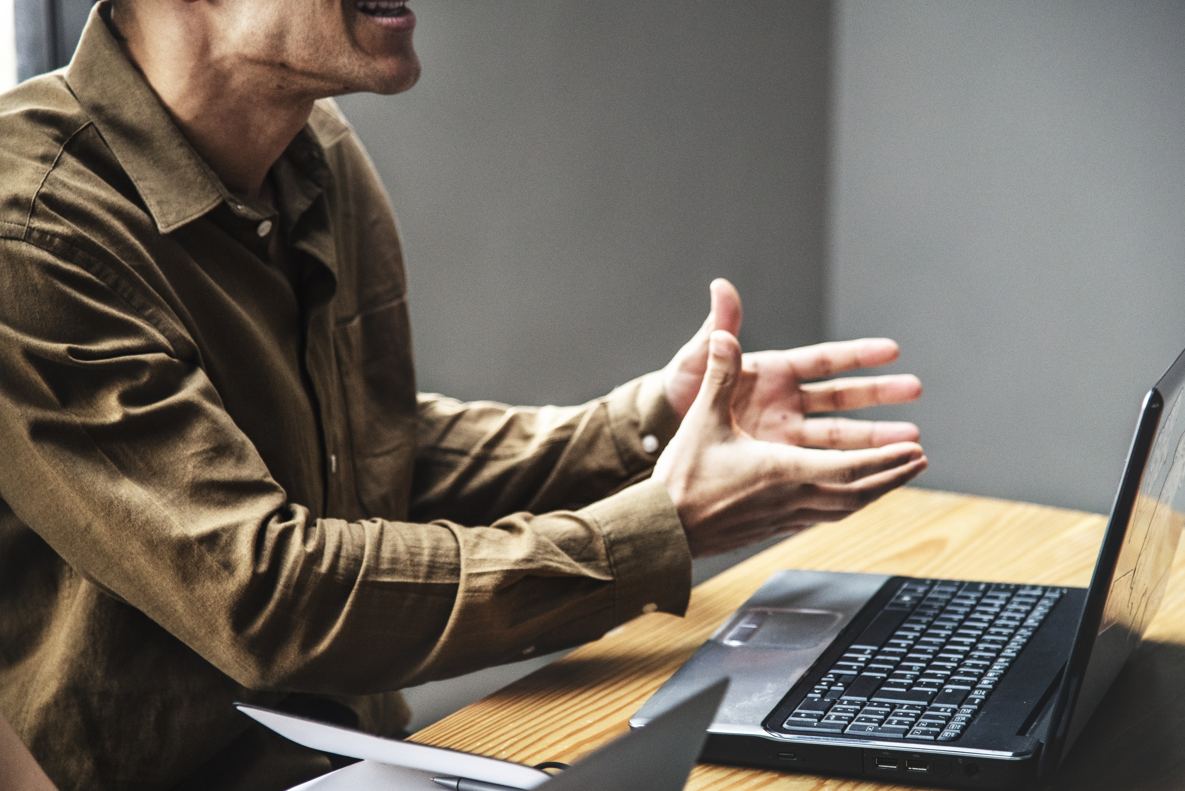 raging man in front of laptop on desk