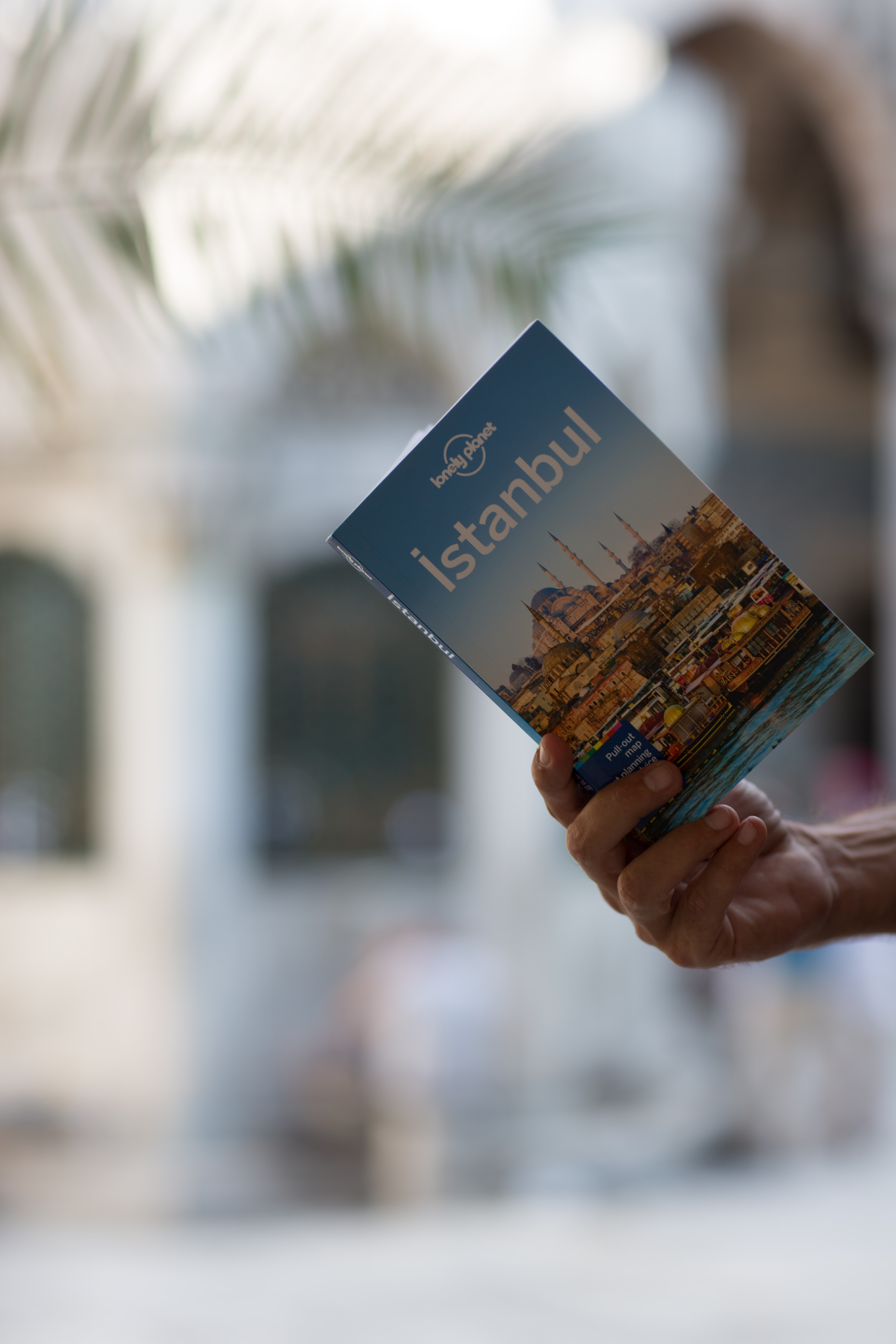 person holding Istanbul book