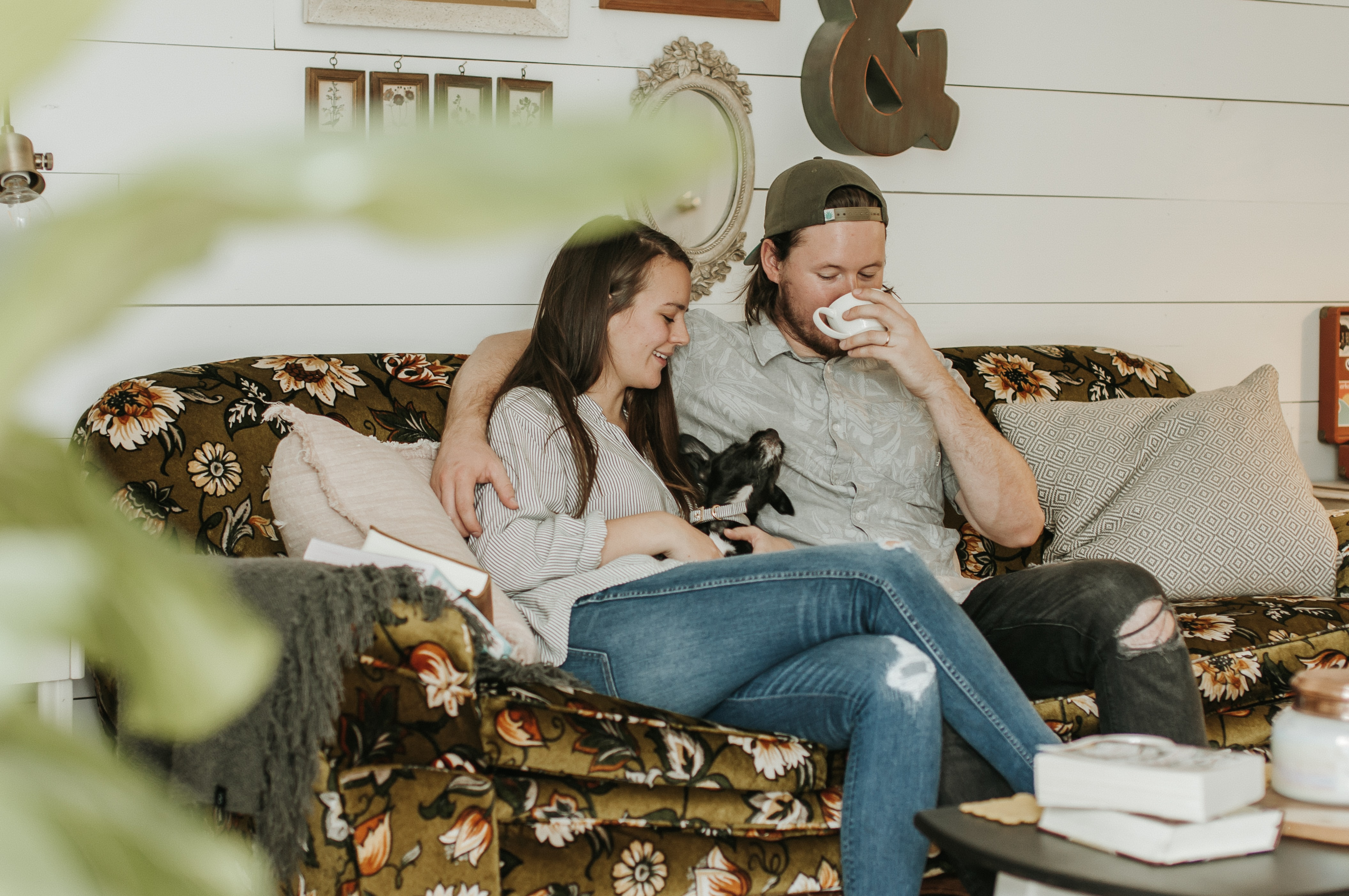 photo of man and woman sitting on sofa
