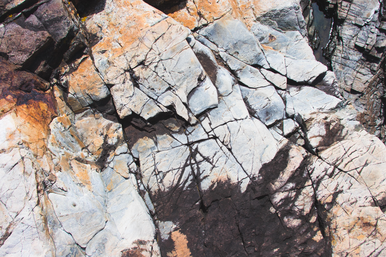 cracked gray and orange rock