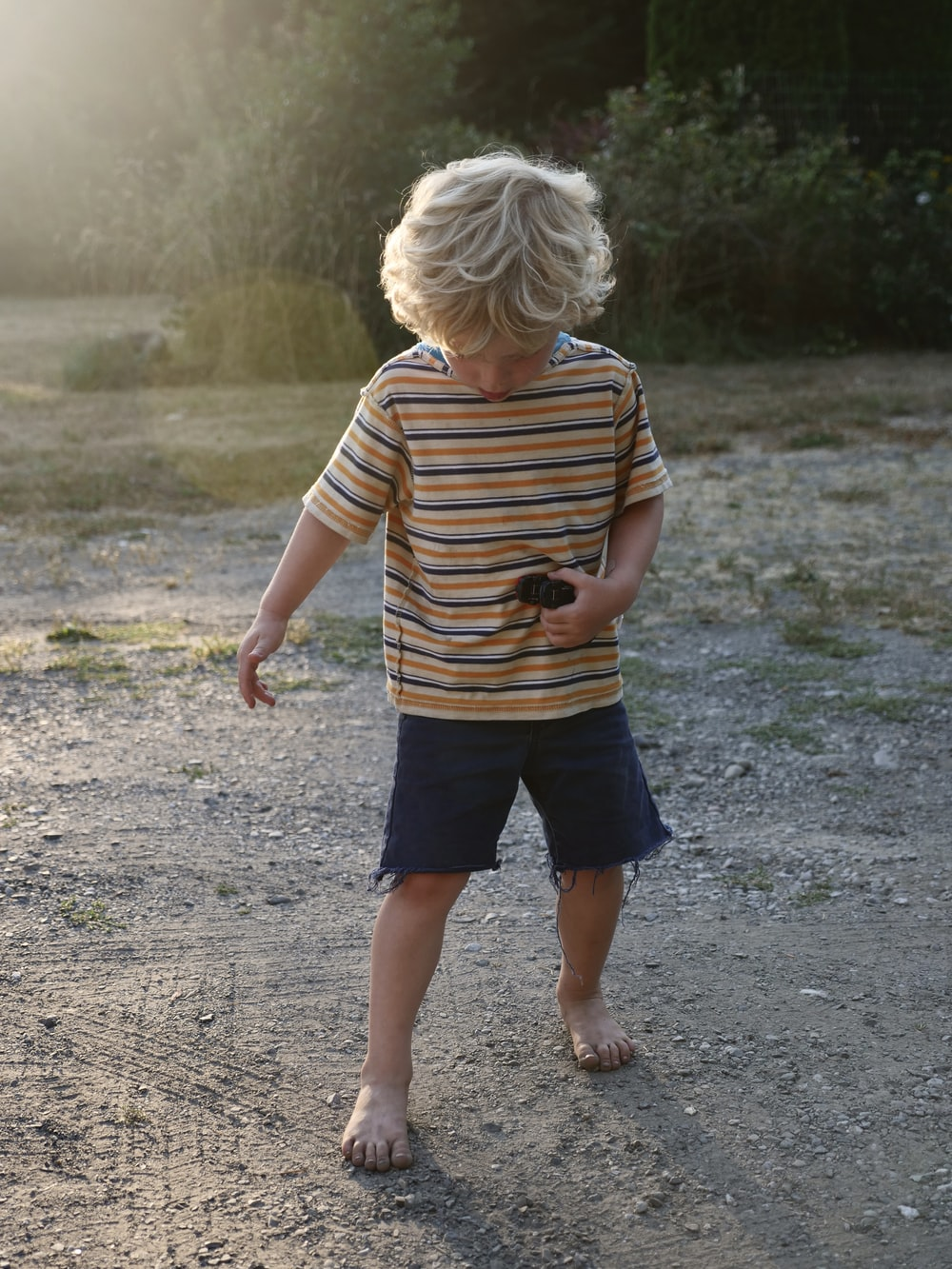 boy wearing brown and black striped t-shirt
