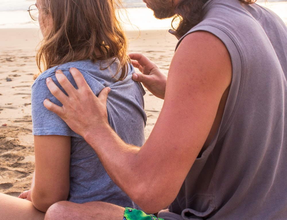 man massaging woman at the back