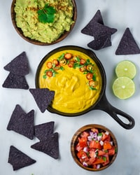 nachos chips with jalapeno and guacamole in bowl