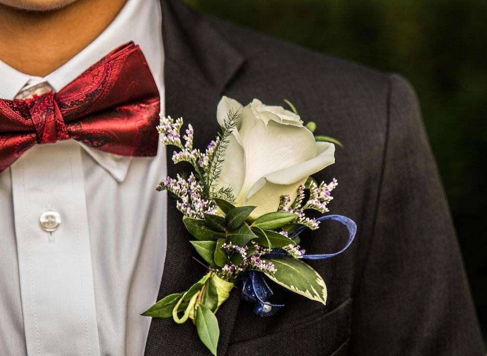 white rose on man's suit jacket