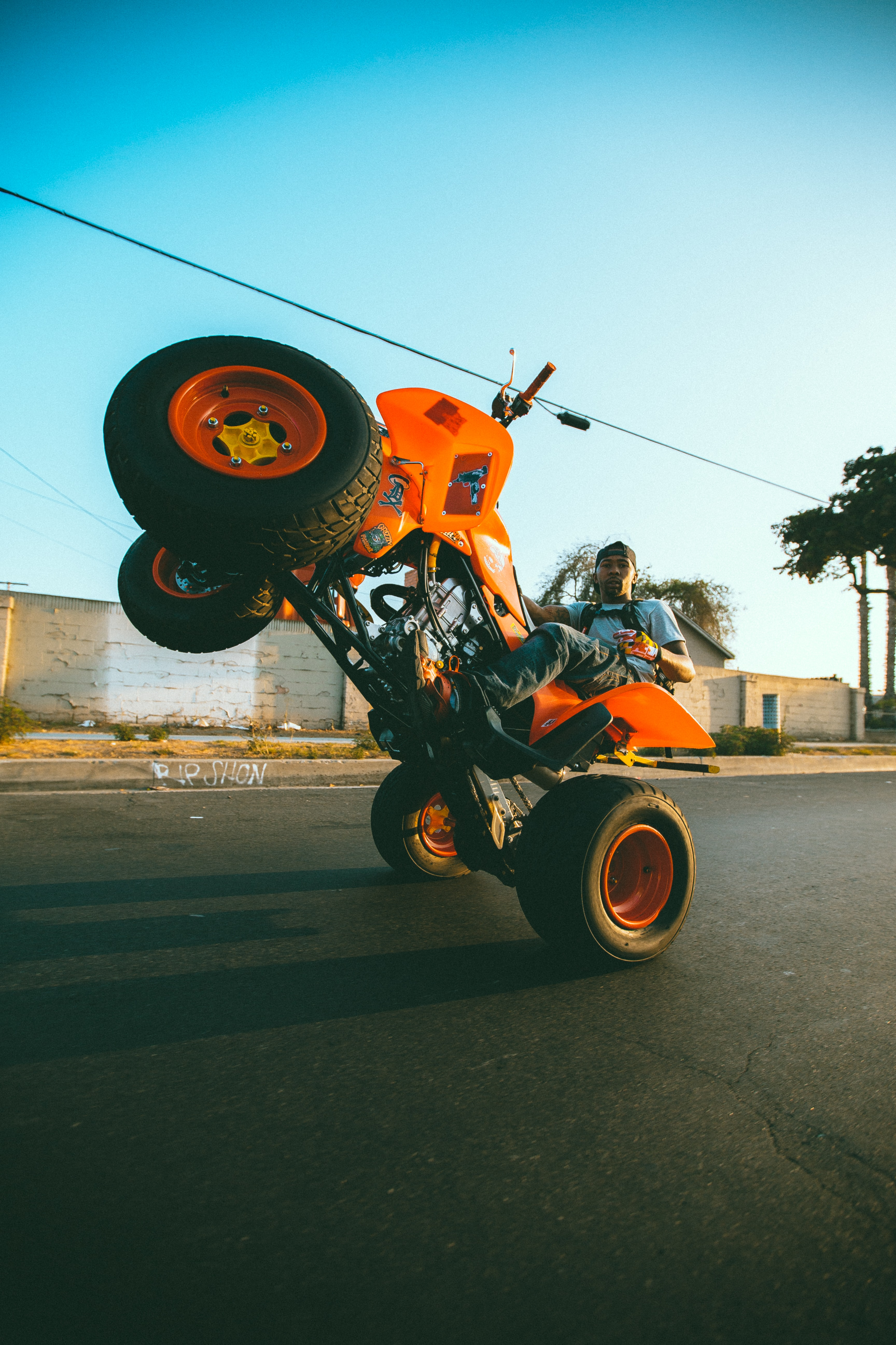 man riding on orange ATV