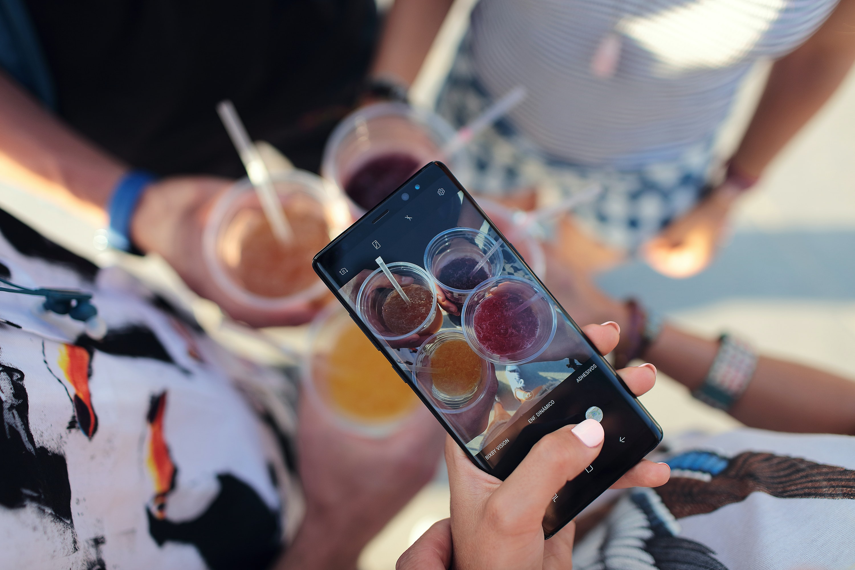 person taking picture of cocktail drinks
