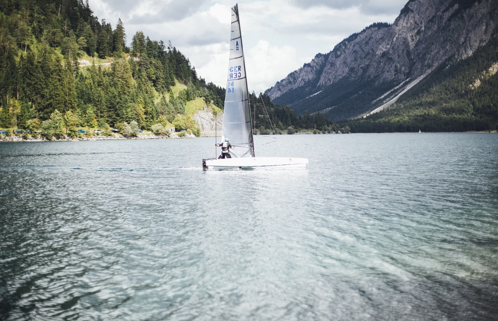 white sailboat on body of water