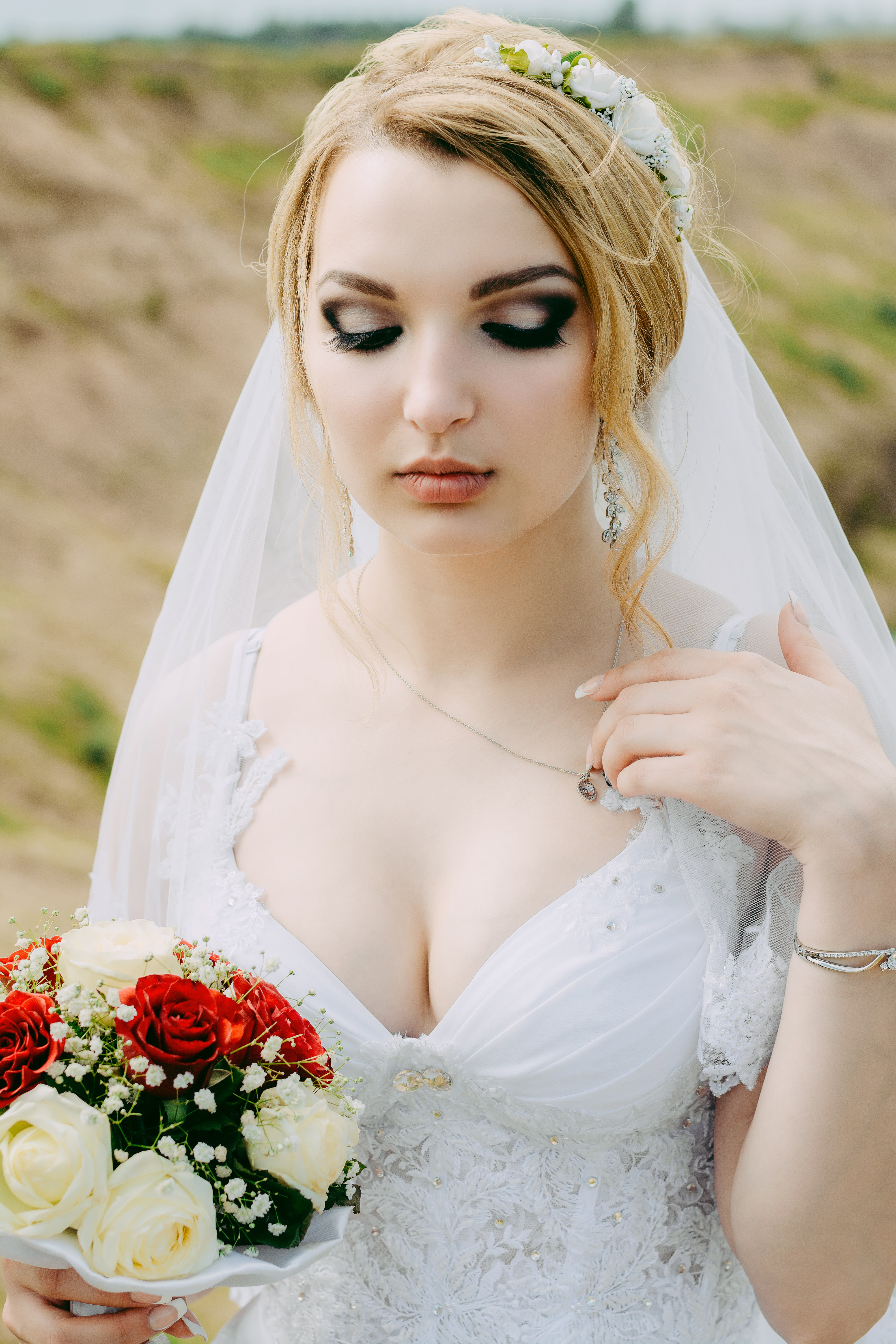 woman wearing wedding gown holding bouquet