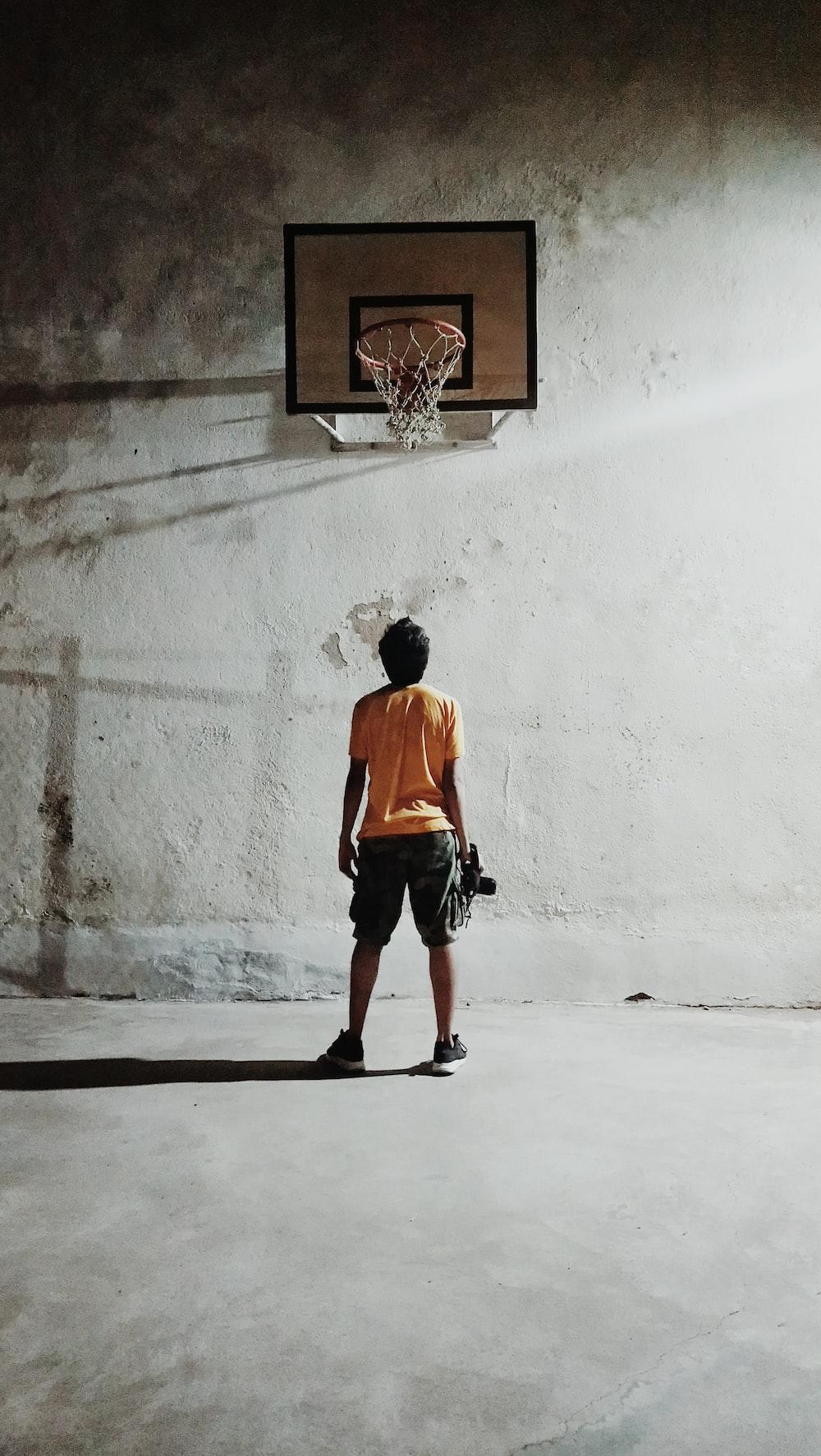 man looking basketball ring