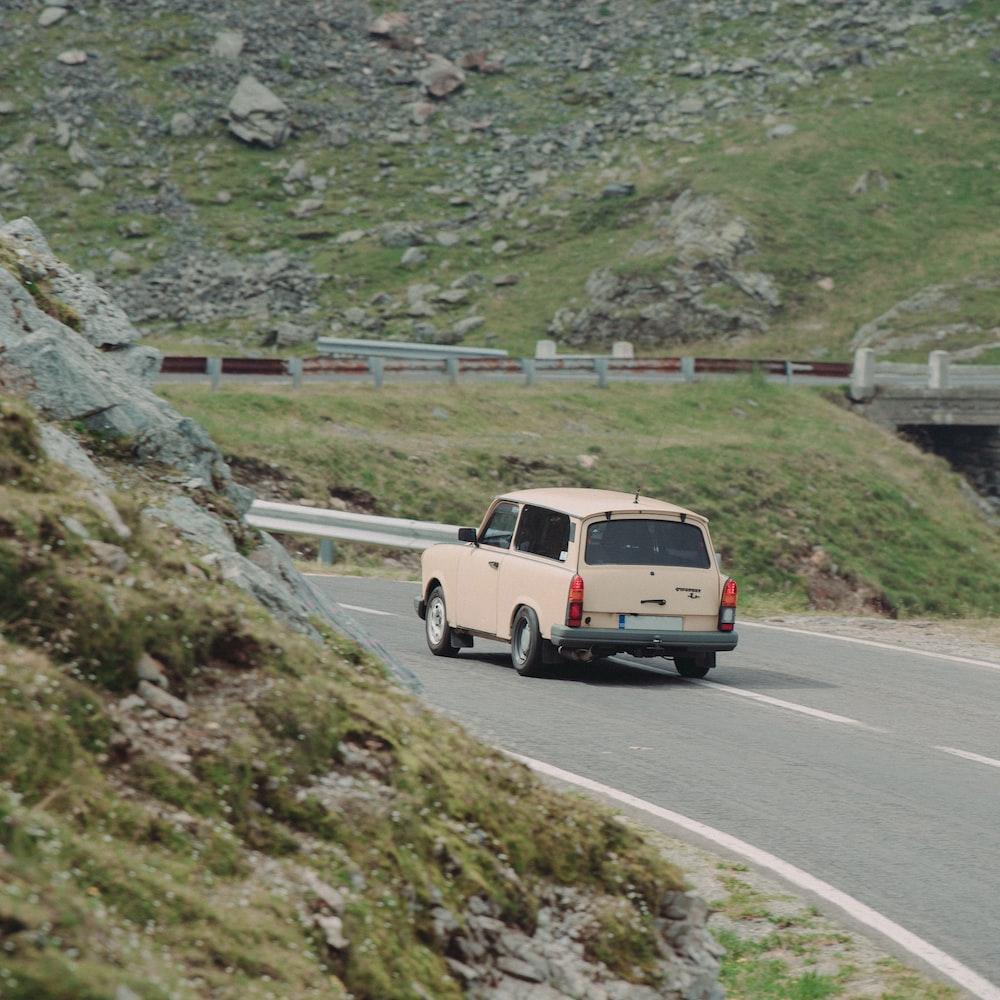 brown car near mountain
