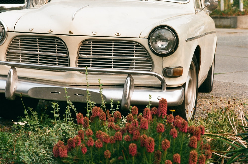 parked white Volvo vehicle