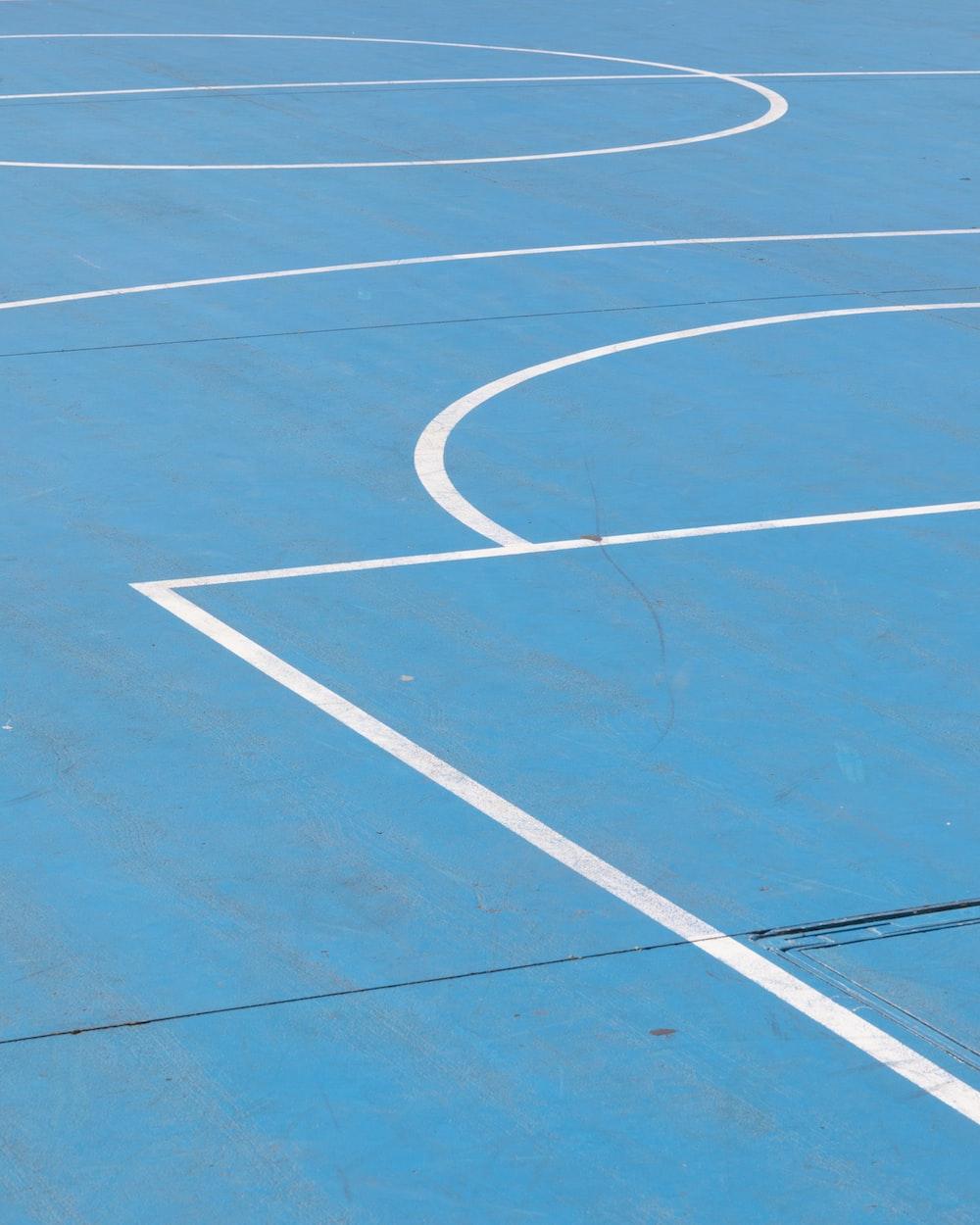 white line on blue basketball floor