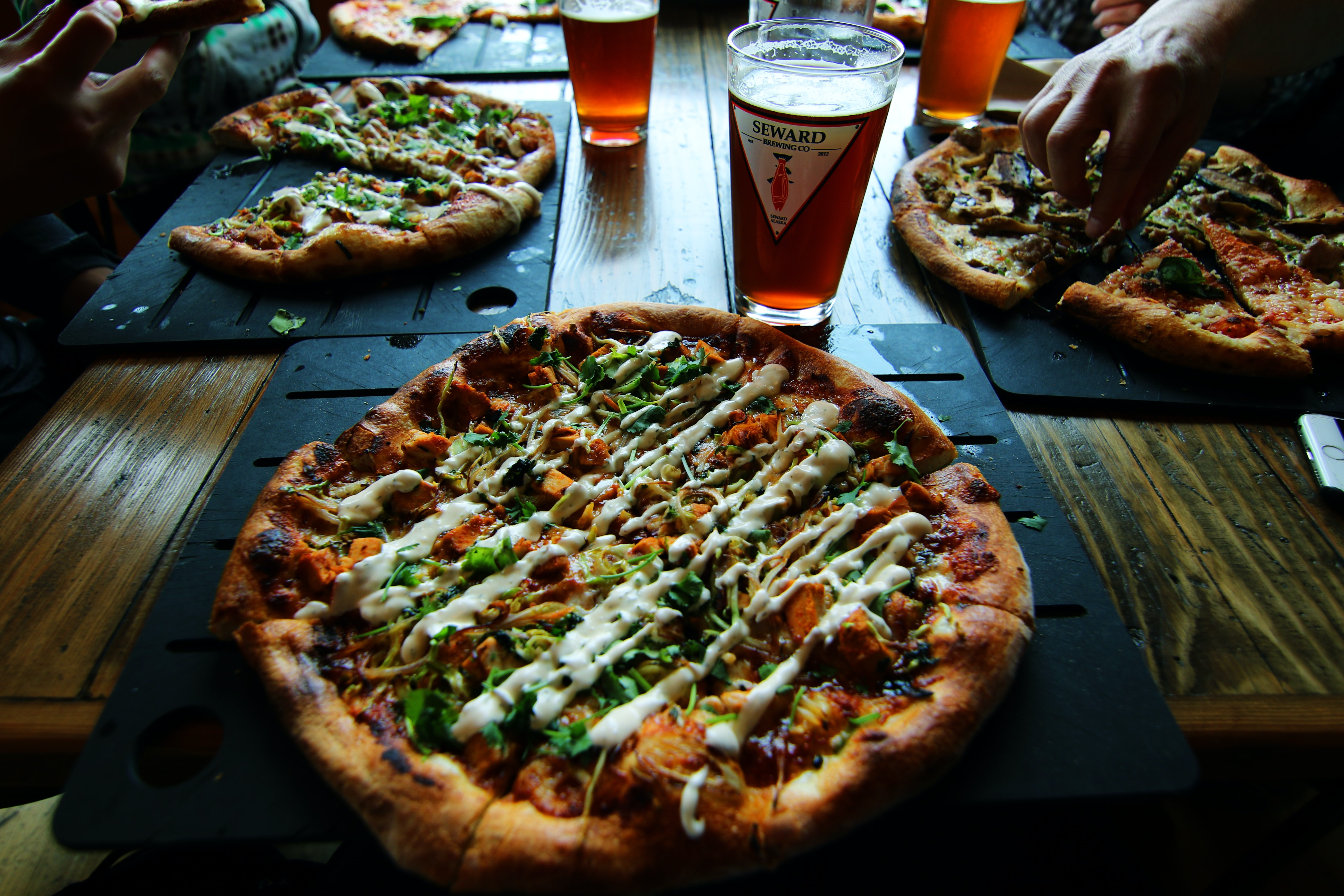 slice pizza on black tray