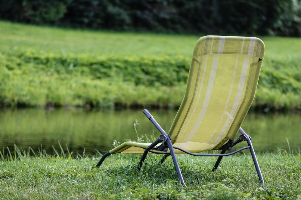 green and black sun lounger on green grass field