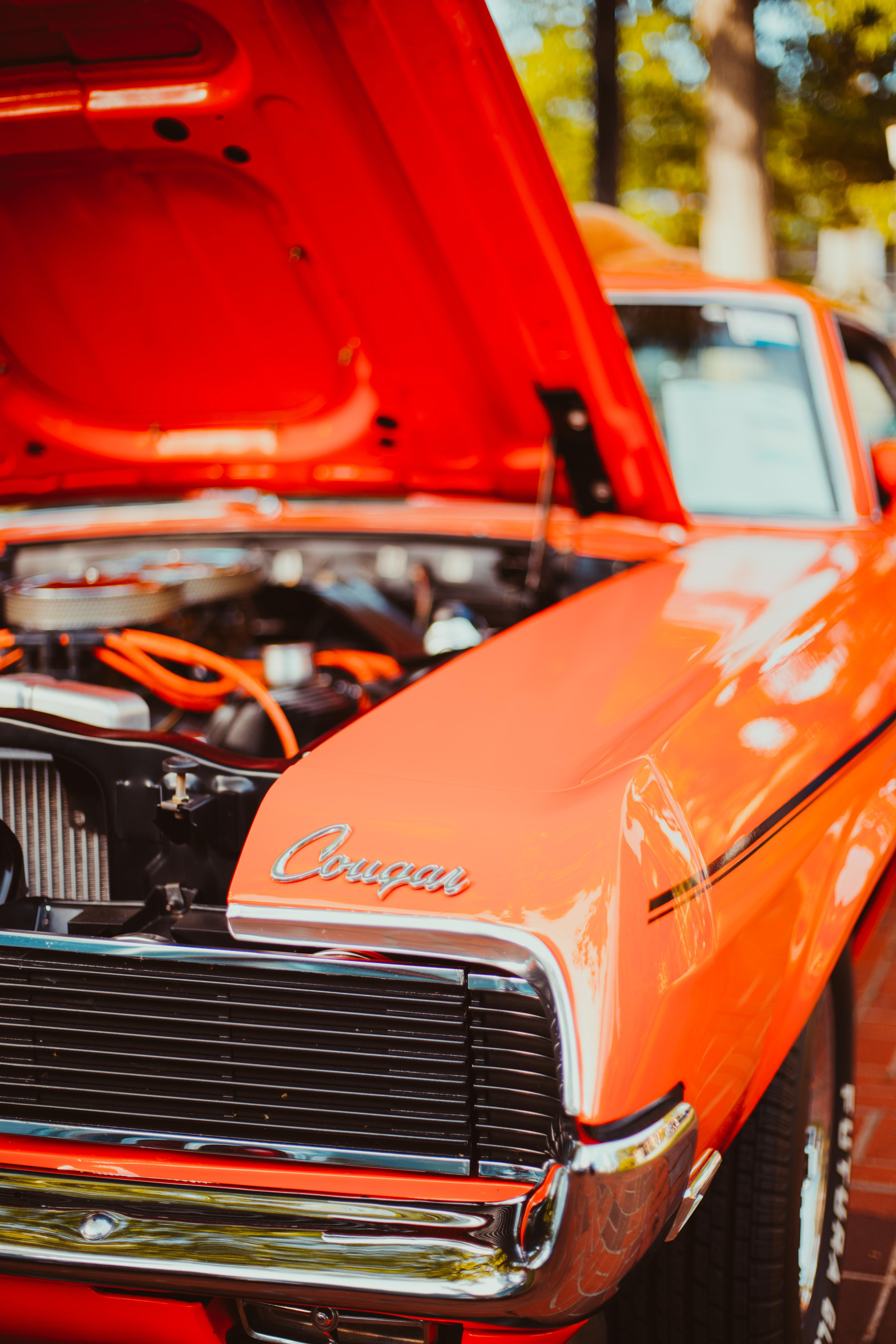 classic orange car with opened front hood