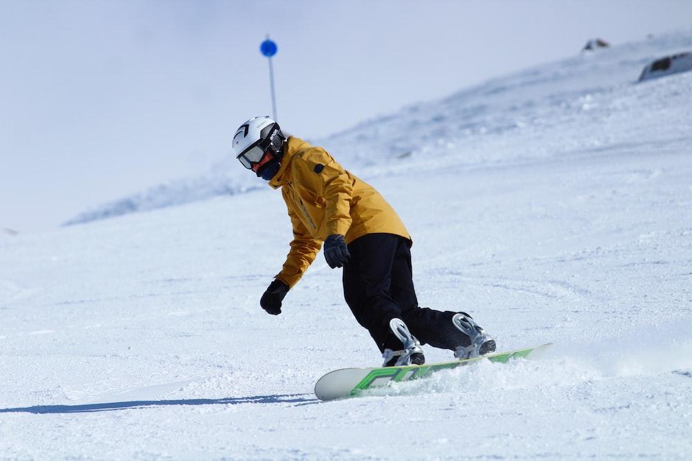 man doing snowboarding