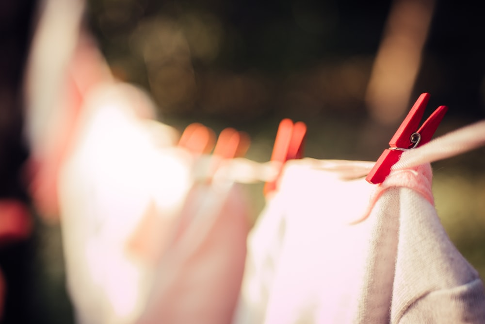 selective focus of red clip on clothesline