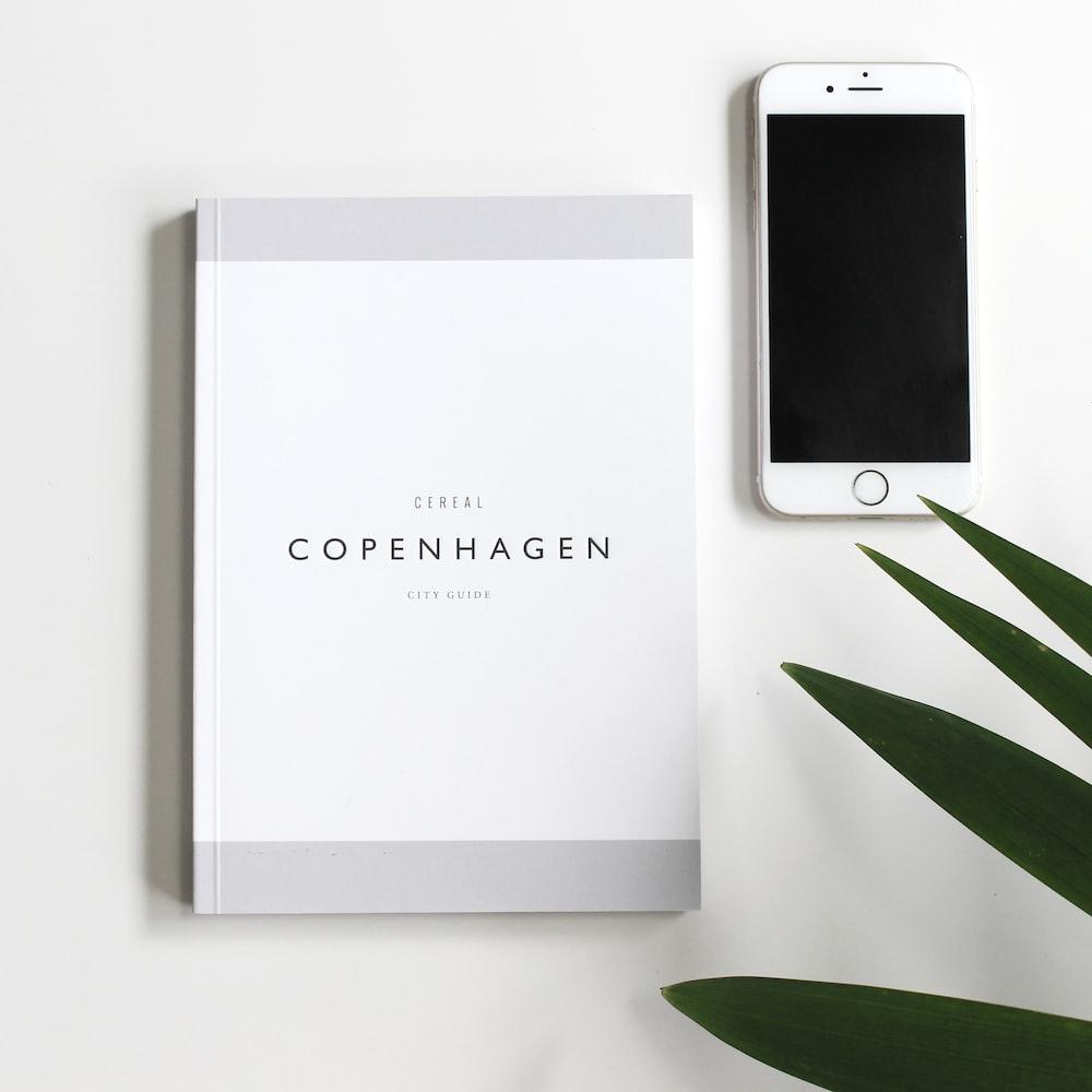 Copenhagen book beside iPhone 6
