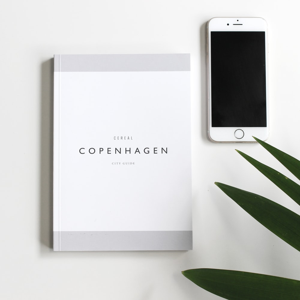 Copenhagen book beside iPhone 6