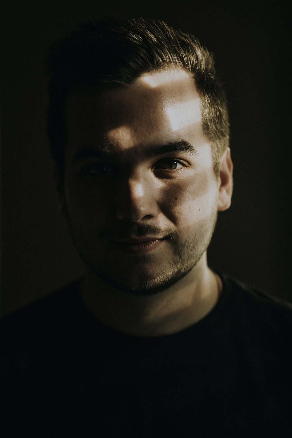 portrait photography of sunlight reflecting on man's face