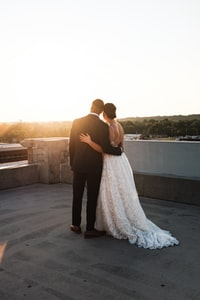 bride and groom standing on rooftop
