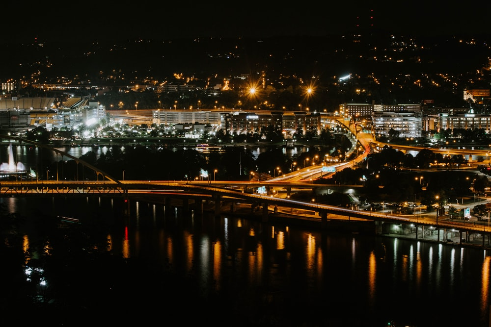 gray concrete bridge during night time