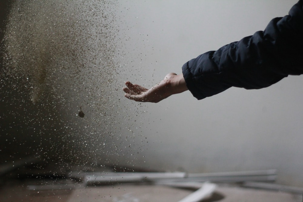 person catching powder
