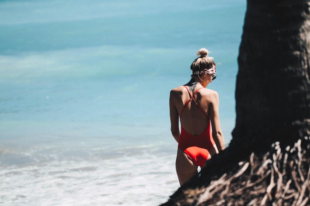 woman standing near the beach