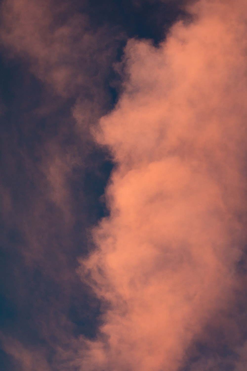 low angle photo of white clouds during twilight