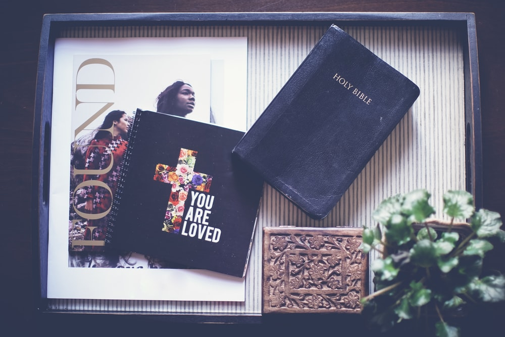 Holy Bible on black wooden tray