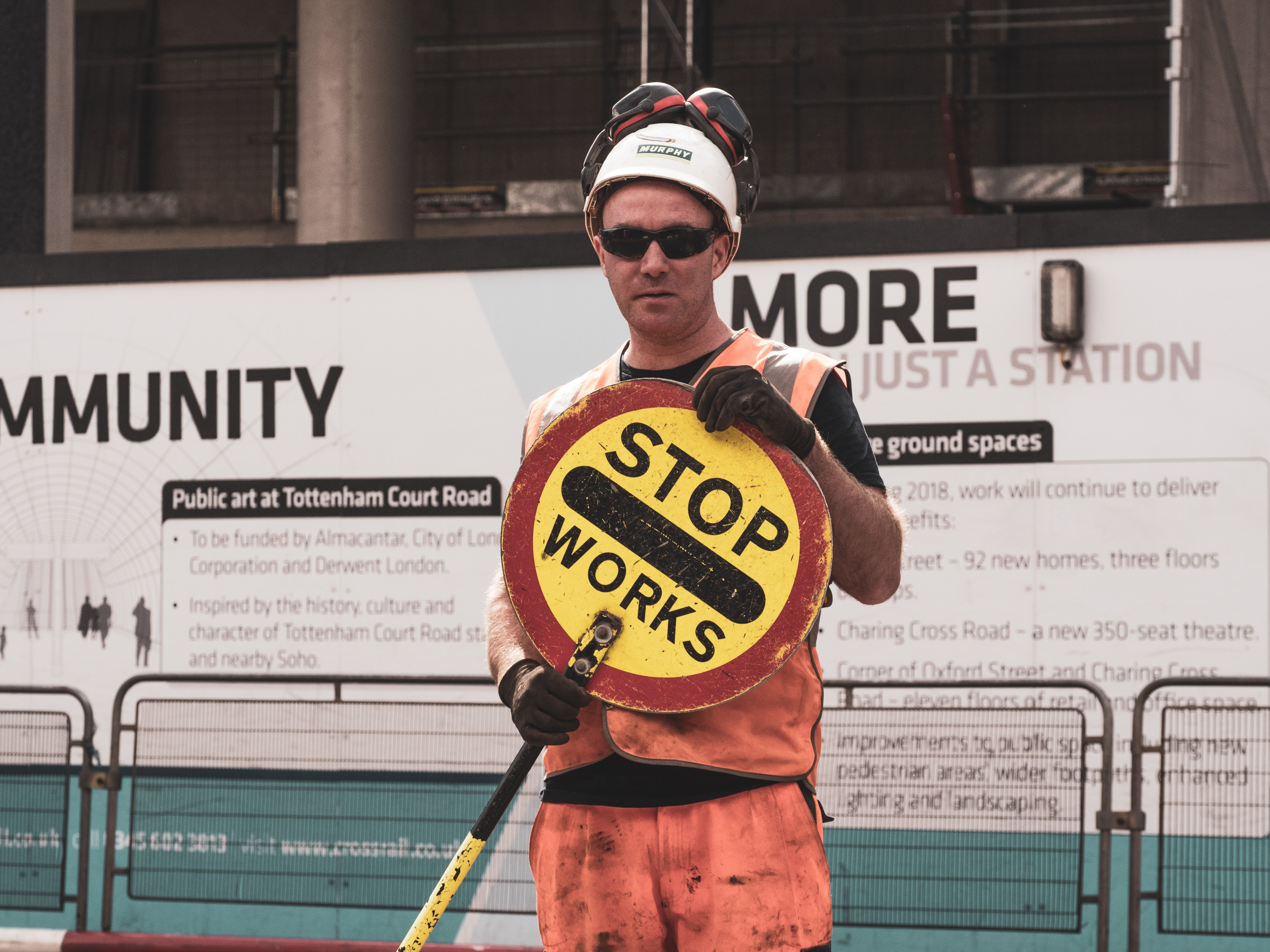 person holding Stop Workers signage
