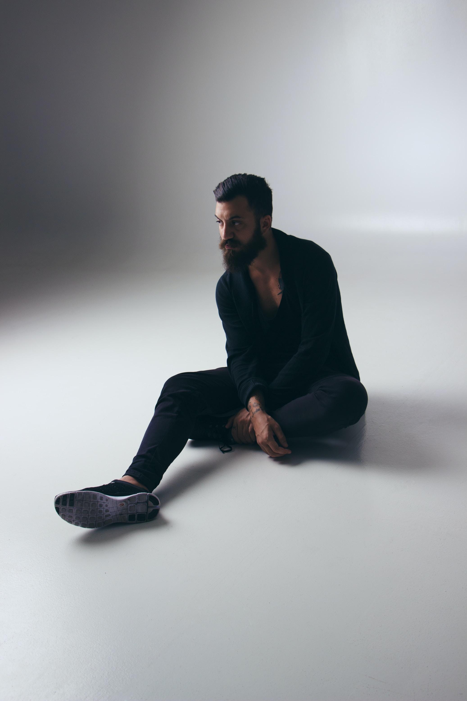 man sitting in white floor