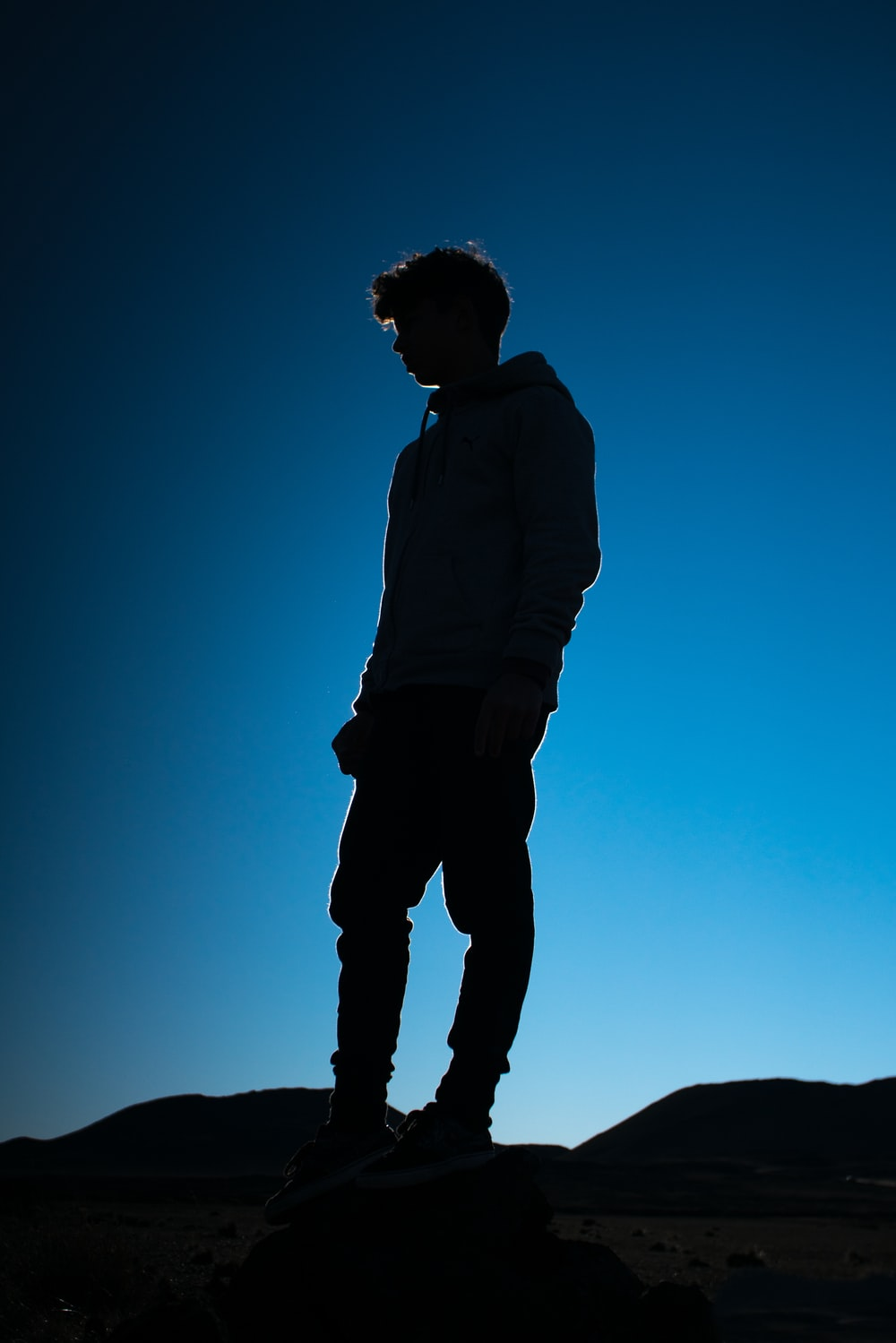 man stand on top of mountain